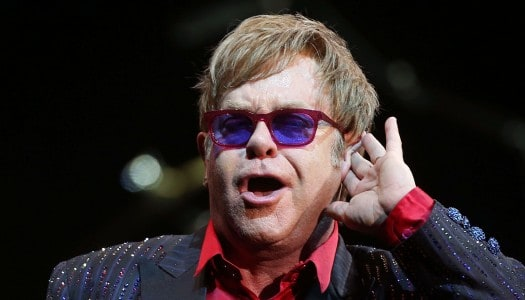 Elton John Turns 68, Keeps Going Like a Rocket