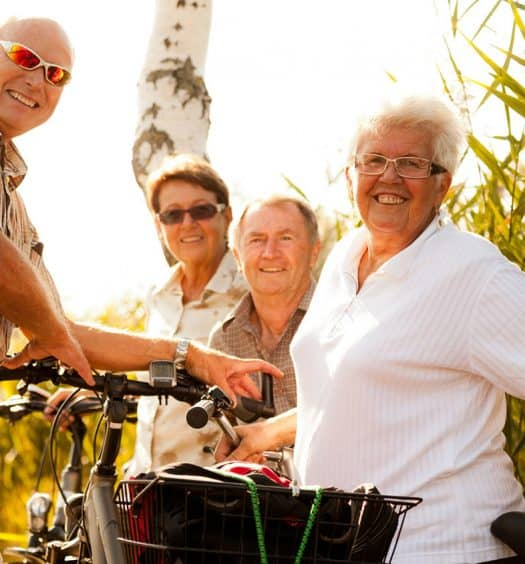 retirees on bicycle