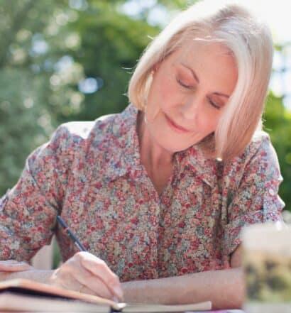 senior woman writing a letter